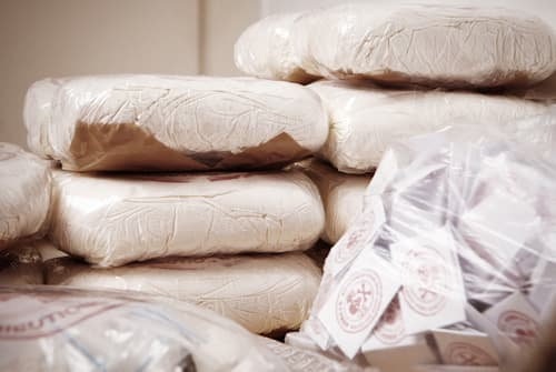 piles of drugs found with drug traffickers