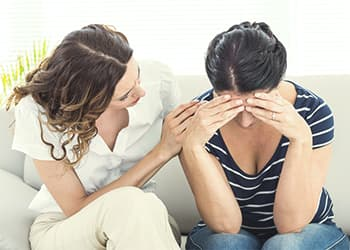 Therapist comforting woman