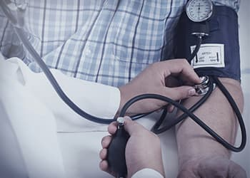 Blood pressure checked by doctor