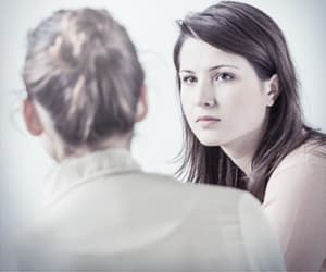 Woman speaking to counselor