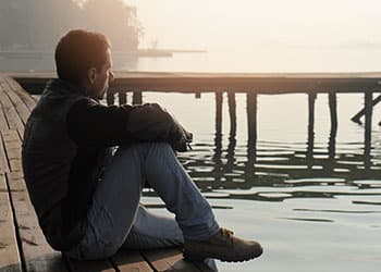 man sitting alone in social isolation