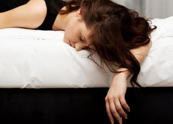 Woman asleep on bed from Zolpidem