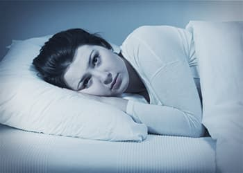 woman having trouble sleeping due to suboxone