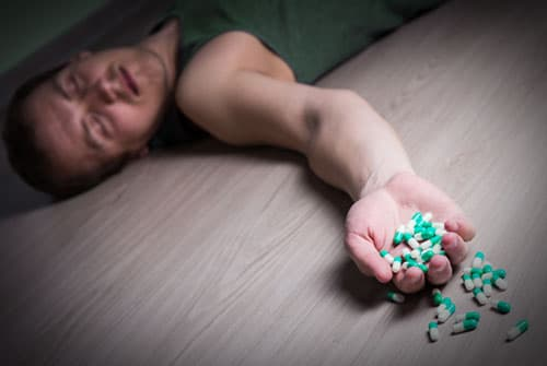 Man passed out on floor abusing Librium pills