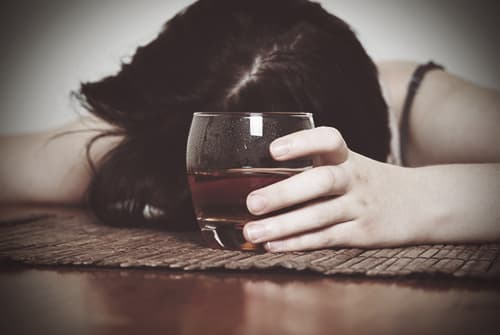 woman passed out from mixing alcohol and pills