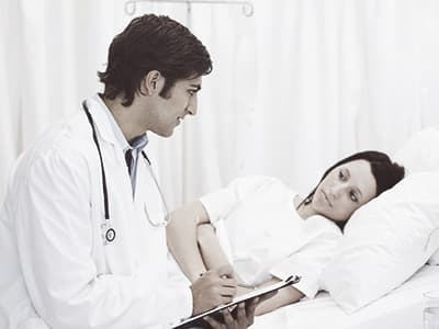 Doctor checking on patient
