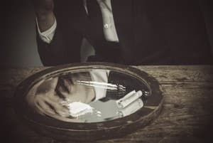 drugabuse_istock-37954892-businessman-snorting-cocaine-on-mirrow-reflection