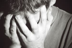 drugabuse_istock-4920511-young-man-sad-head-in-hands