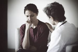 drugabuse_istock-66177067-woman-being-comforted-by-doctor