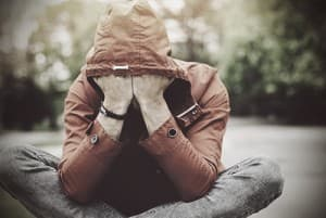drugabuse_istock-67628873-young-man-in-jacket-head-in-hands