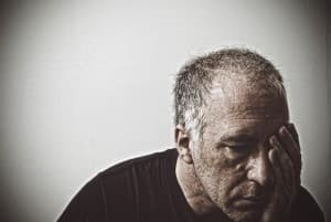 drugabuse_istock-7503593-old-man-sad-head-in-palm-of-hand