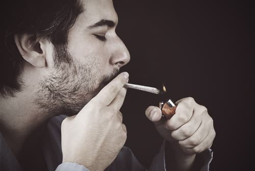 man-smoking-PCP-cigarette