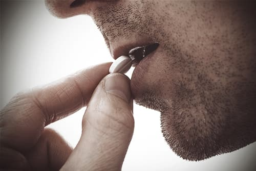 drugabuse_shutterstock-192263777-man-taking-pill-FI