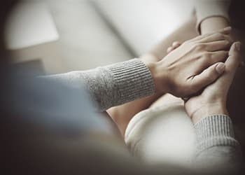 drugabuse_shutterstock-229879537-psychiatrist-comforting-patient-holding-hand