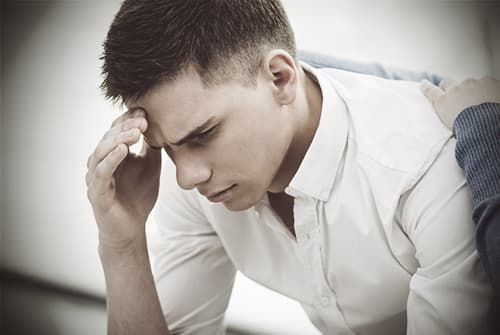 drugabuse_shutterstock-242965123-sad-man-in-support