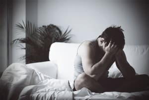 drugabuse_shutterstock-258931763-man-sad-in-bed-concurrent-ultram-alcohol