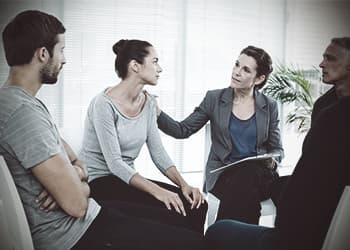 drugabuse_shutterstock-300390626-woman-in-group-therapy-being-comforted-by-counselor