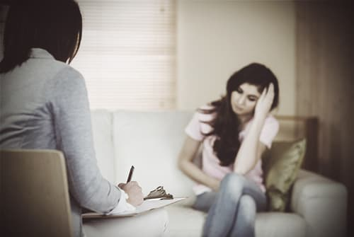 young-woman-telling-personal-beliefs-to-therapist