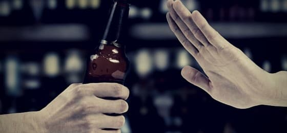 hand saying no to alcohol