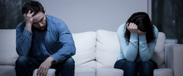 man and woman on couch dealing with addiction